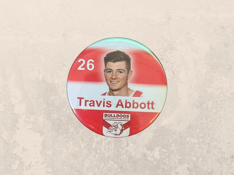 Travis Abbott Badge